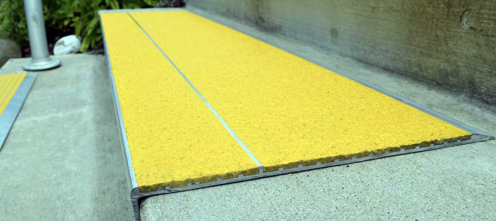An example of our Stair Tread, but with yellow covering provide full-tread protection across the entire step.
