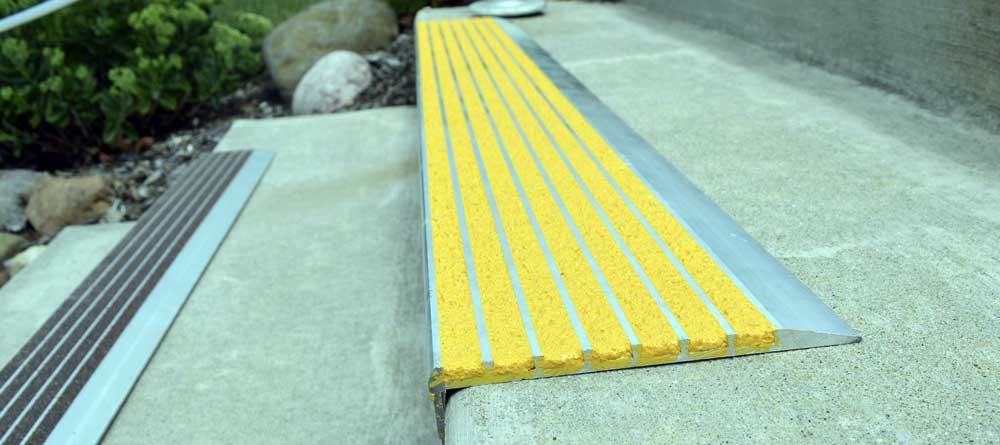 An example of our Stair nosing, but with yellow covering provide full-tread protection across the entire step.
