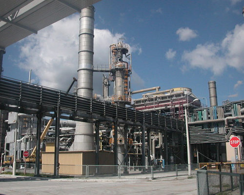 an exterior shot of a factory with a lot of different types of piping