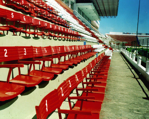 A generic picture of a stadium and it's tiered seats.