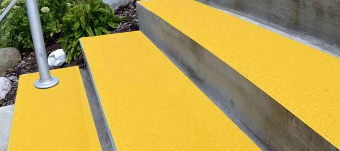 A yellow Non-slip coatings offer custom, non-slip coverage of any surface.